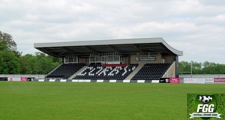 corby-town-fc-steel-park-stadium-main-stand-1438423504