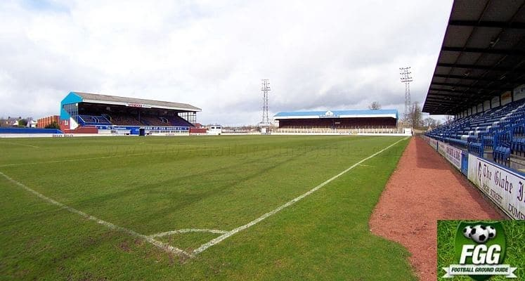 queen-of-the-south-fc-palmerston-park-main-stand-and-portland-drive-terrace-1435051364